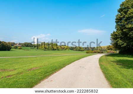 Image of a national park in Bonn, Germany with flowers, pathways, trees and lush green grass - stock photo