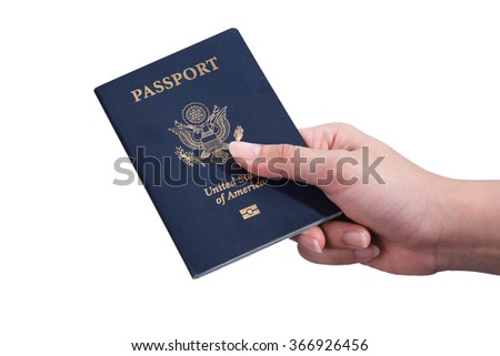 Image of a persons hand holding a passport on isolated white background, with clipping path