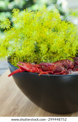 Image of a pot of fresh crayfish and dill. - stock photo