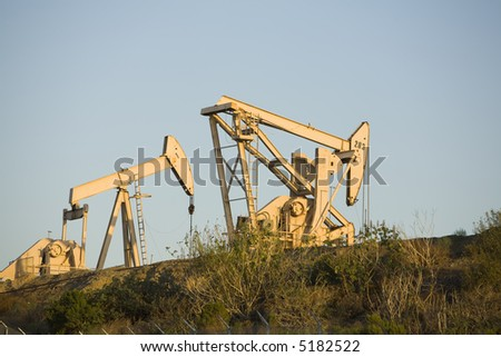 Image of a pumpjack type oil pump.  Also known as a nodding horse, nodding donkey, thirsty bird, beam pump or horsehead pump. - stock photo