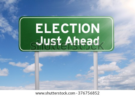 Image of a road sign with a text of election just ahead under clear sky - stock photo
