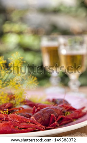 Image of a serving of crayfish and sprigs of dill for a traditional swedish crayfish party. - stock photo