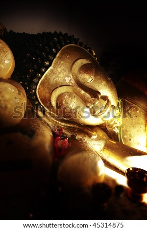 image of a sleeping buddha - stock photo