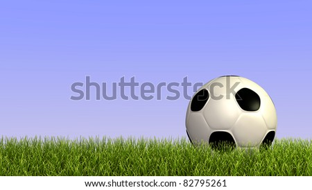Image of a soccer ball on grass against a blue sky background. - stock photo