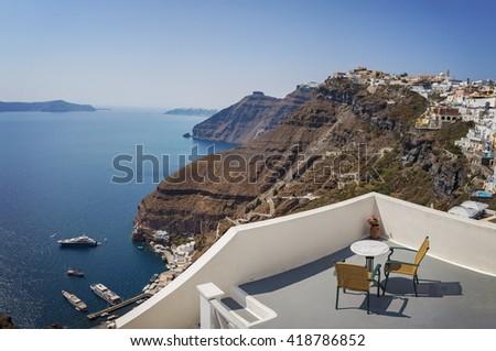 Image of a sun terrace with breathtaking views. Santorini island, Greece.  - stock photo