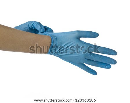 Image of a surgeon wearing sanitized medical gloves on a white background - stock photo