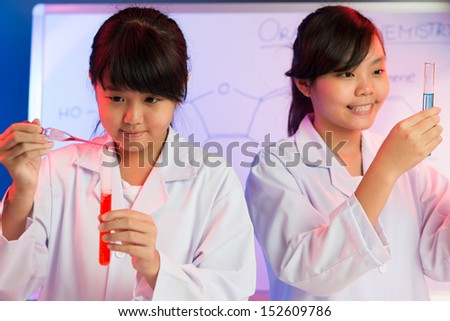 Image of a teenager with a dropper and a tube on the foreground - stock photo