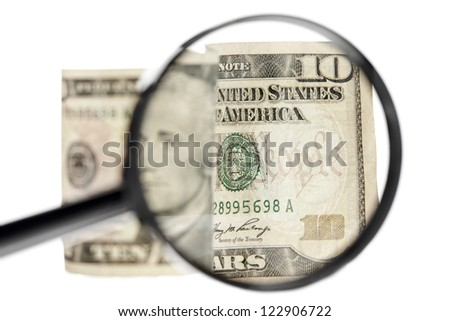 Image of a ten dollar bill with a magnifying glass inspecting the money - stock photo