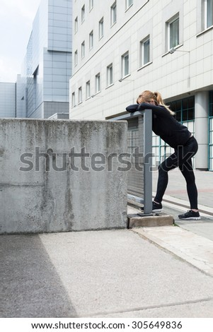 Image of a tired lady after training - stock photo