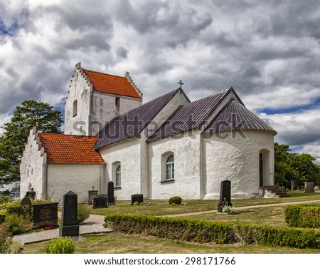 Image of a traditional medieval whitewashed church. Ravlunda, Sweden.