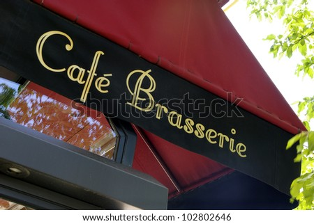 Image of a typical Parisian caf���© sign - stock photo
