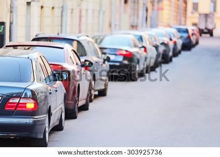 image of a vehicles parked near the road - stock photo