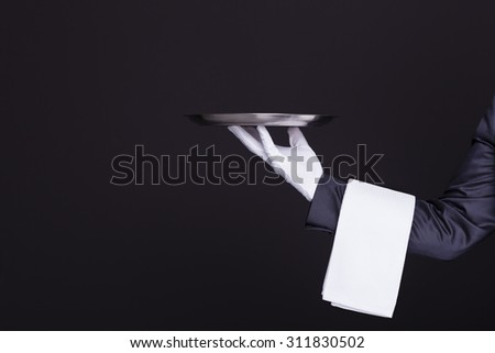 Image of a waiter hand holding an empty silver tray - stock photo