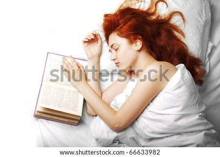 Image of a woman who reads a book in bed - stock photo