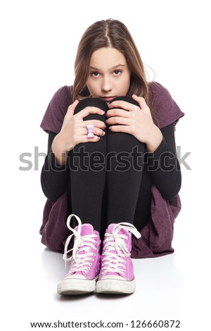 Image of a worried beautiful teenage girl, isolated on white - stock photo