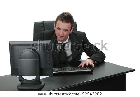 Image of a young businessman working on his computer.
