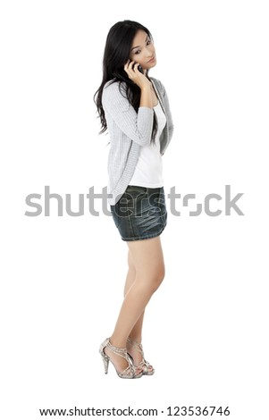 Image of a young female talking on mobile phone - stock photo