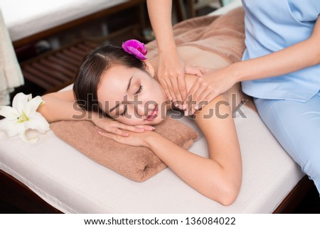 Image of a young girl relaxing in spa salon - stock photo