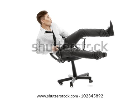 image of a young man rolling on chair - Rolling Chair
