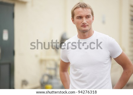 Image of a young Russian man in the city - stock photo