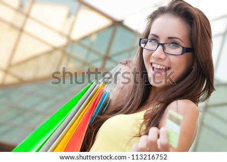 Image of a young woman with shopping bags - stock photo