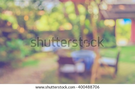 image of Abstract blurred outdoor coffee hut on day time , in garden for background usage . (vintage tone) - stock photo