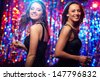 Image of adorable girls in motion enjoying themselves in the club - stock