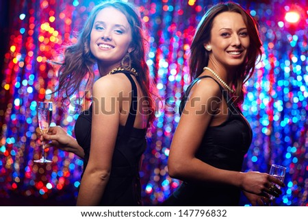 Image of adorable girls in motion enjoying themselves in the club - stock photo