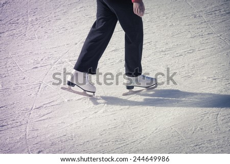 Image of adult who are ice skating at the ice rink outdoors at Medeo - stock photo