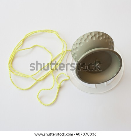 image of aluminum yoyo with anodized finish with fluorescent yellow string laying on a pedestal - stock photo