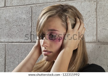 Image of an abused and confused woman - stock photo