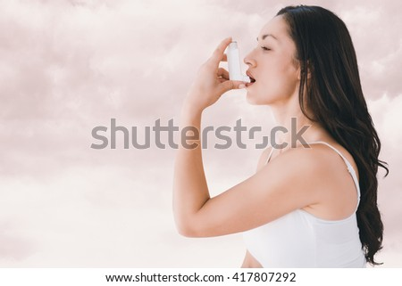Image of an asthmatic woman against light grey - stock photo
