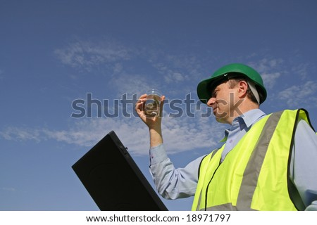 Image of an ecologist taking samples of the environment - stock photo