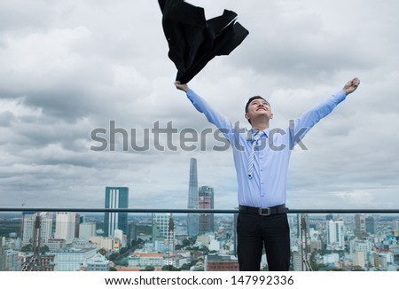 Image of an excited businessman having success in business - stock photo