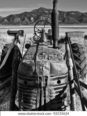 Image of an old tractor on a farm. - stock photo