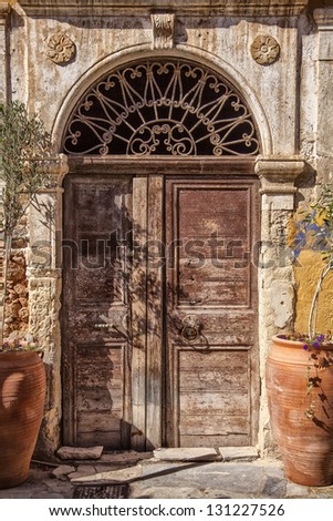Image of an old worn door. Chania, Greece. - stock photo