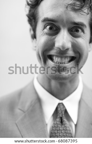 Image of an unusual businessman with a big smile - stock photo
