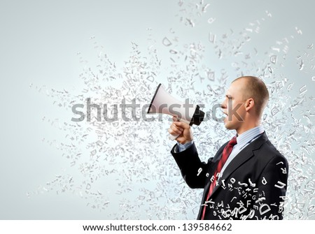 Image of angry businessman screaming in megaphone - stock photo