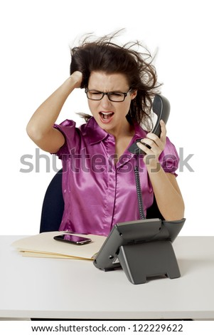 Image of angry office girl yelling while holding the telephone against white background