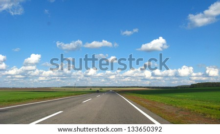 image of asphalted road and the blue sky