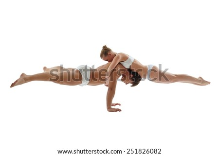 Image of athletes keeping balance in handstand - stock photo