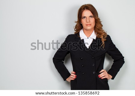 Image of attractive caucasian businesswoman  over grey background