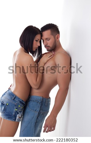 Image of attractive couple hugging at camera