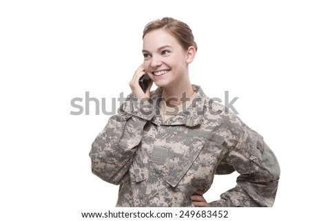 Image of attractive female soldier talking on cell phone against white background - stock photo