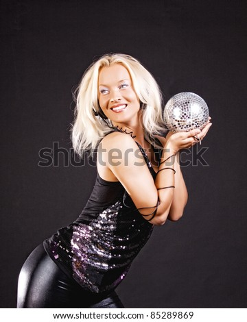 Image of attractive girl at party holding disco ball - stock photo