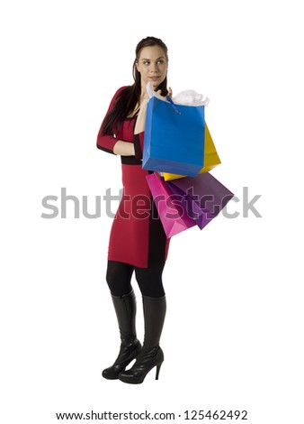 Image of attractive lady with shopping paper bags against white background