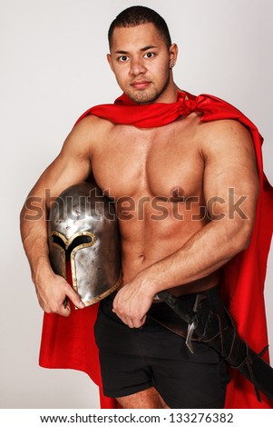 Image of barbarian with red mantle and helmet - stock photo