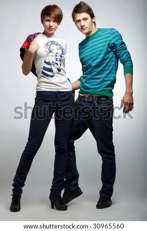 Image of beautiful fashion couple shot in studio - stock photo