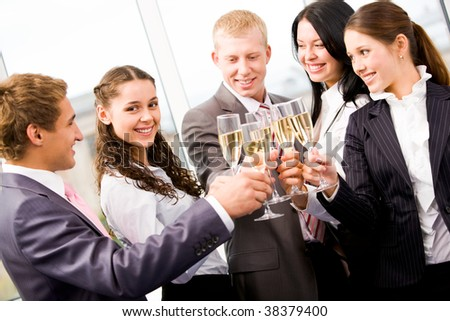 Image of beautiful female looking at camera among her cheering friends - stock photo