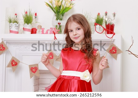 Image of beautiful little girl in red dress over valentine day background - stock photo
